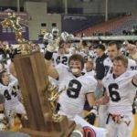Valley players celebrate as they prepare to grab the state championship trophy at the UNI Dome on Friday night after topping Bettendorf 17-14.
