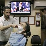 Men listen to Obama's speech in a Palestinian barbershop in the West Bank city of Ramallah on May 19.