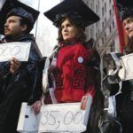Protesters in Zuccotti Park staged a mock graduation ceremony featuring graduates wearing duct-tape chains to symbolize the burden of debt.