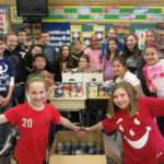 Morgan Elementary fifth graders Meghan Fowler, Rachel Doan, Christopher Burger, Aidan Njanja-Fassu, Emily Mozgai, Alexis McClure, Noelle Muni, Andy Dong, Ben Kelly, Edwin Martinez, Nate Greenberg, Julia Zalvino, Zac Collins, Joseph DiGeronimo, Jake Knab, De'Iavion Gregory, Caylee Aanonsen, Isabella Salvatore, Julia McCarty and Natalie Kozemchak with their donations to the Annual Souper Bowl of Caring food drive.