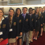 Lawrence High School DECA members Allison Foltiny, Jordannah Schrieber, Tithi Patel, Thomas Ikeda, Shakil Yoosuf, Linda Luo, Marie Buschman, Andrew Moldoff, Criswell Lavery, David Eggert, Kevin Hanko and Patrick Lavery pose during the conference in May.