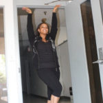 LaToya James gets in a dancing mood as she displays the inside of Dream Makers Studios. (Photo by Brandon Gould.)