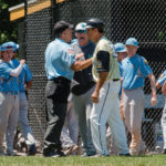 Hopewell Post 339's Nick Psomaras is called out attempting to evade a tag at home plate against North Hamilton on June 12, 2016. A heated argument among coaches and umpire (right) ensued. Hopewell won, 8-6. (Photos by Suzette J. Lucas.)