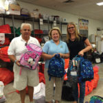 John and Jean Gianacaci pose with backpacks donated by Christine's Hope For Kids, the nonprofit founded in honor of their daughter.