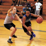 web1_-1-kyla-peterson-works-the-ball-to-the-basket.jpg