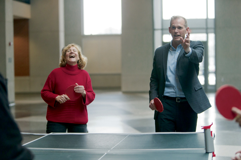 Assistant superintendent Kathie Foster laughs at a joke made by superintendent Steve Mayer while playing table tennis at Robbinsville High School's Chinese New Year celebration Feb. 5, 2016. Mayer was a constant presence in the schools, especially the high school, where his office was located. (File photo.)