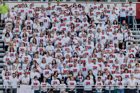 A crowd of 1,200 people wore white and packed the stands at the Robbinsville High boys' lacrosse game against West Windsor-Plainsboro North in honor of Steve Mayer April 25, 2016. Mayer's son, Kyle, is on the team. (Photo by Suzette J. Lucas.)