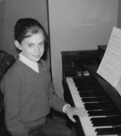 Snider at the piano, age 10.